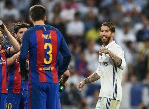 MADRID, SPAIN - APRIL 23:  Sergio Ramos of Real Madrid (R) reacts towards Barcelona players as he is sent off during the La Liga match between Real Madrid CF and FC Barcelona at Estadio Bernabeu on April 23, 2017 in Madrid, Spain.  (Photo by David Ramos/Getty Images)