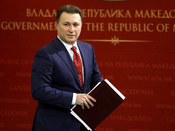 """Macedonian Prime Minister Nikola Gruevski leaves after a news conference in the government building in Skopje, Macedonia, Wednesday, Feb. 25, 2015.  Gruevski  has immediately dismissed claims of illegal wire-tapping made by opposition leader Zoran Zaev and has reiterated the previous accusation that Zaev was plotting to overthrow the government in collaboration with unidentified """"foreign services"""". (AP Photo/Boris Grdanoski)"""