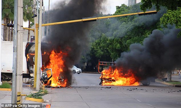 19865906 7586525 Vehicles Burn In A Street Of Culiacan State Of Sinaloa Mexico On A 115 1571372375970