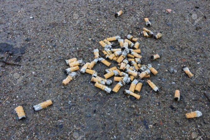 50104849 Cigarette Butts On Ground 696x464